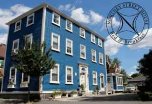Whole 3 story colonial blue Federal Style historic Northey Street House Bed and Breakfast inn Salem MA with long driveway for 5 parking spaces & eco-friendly accommodations
